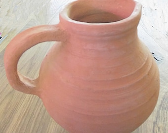 Hand-turned jug modelled on the medieval model made of unglazed stoneware