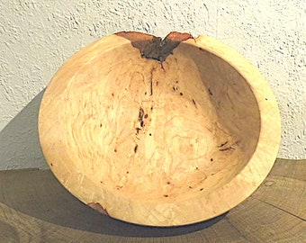 natural hand-turned dish made of ash maser wood with cinder inclusion