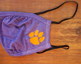 Tiger Paw Facemask. Purple facemask with nose piece. Goes around head, not ears.