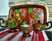 Khokhloma. Vintage tea set. Home decoration. Russian patterns. Hand-painted dishes. Decor element for home, kitchen. Russian culture. Gift.