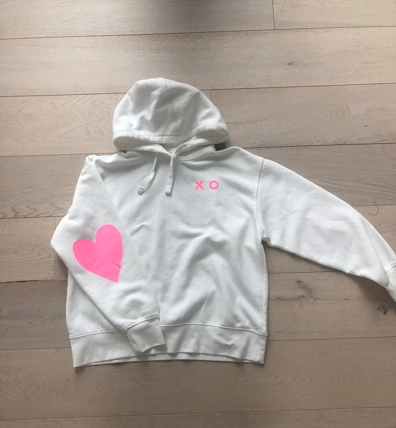 Women\u2019s hand painted pink heart hoodie size large.