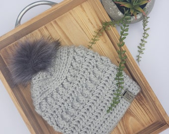 Gray beanie hat toque with fur pom pom