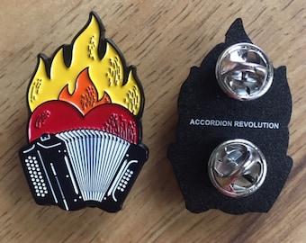 "Flaming-Heart Enamel Pins: ""Accordion Revolution"""