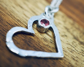 Silver heart pendant with red spinel | Hammered heart necklace | Handmade sterling silver jewellery