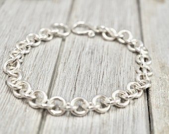 Chunky Sterling silver bangle with polka dot charms Australian made mixed metal jewellery