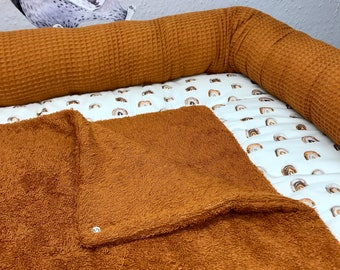 Wrap pad with brown rainbows, different sizes
