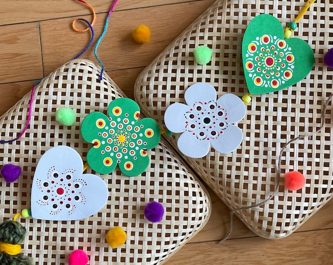 Boho handmade lightweight wall hanging, in green and white foam cut outs of hearts and flowers