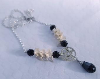 Pentagram snake vertebrae bone pendant necklace with black glass beads
