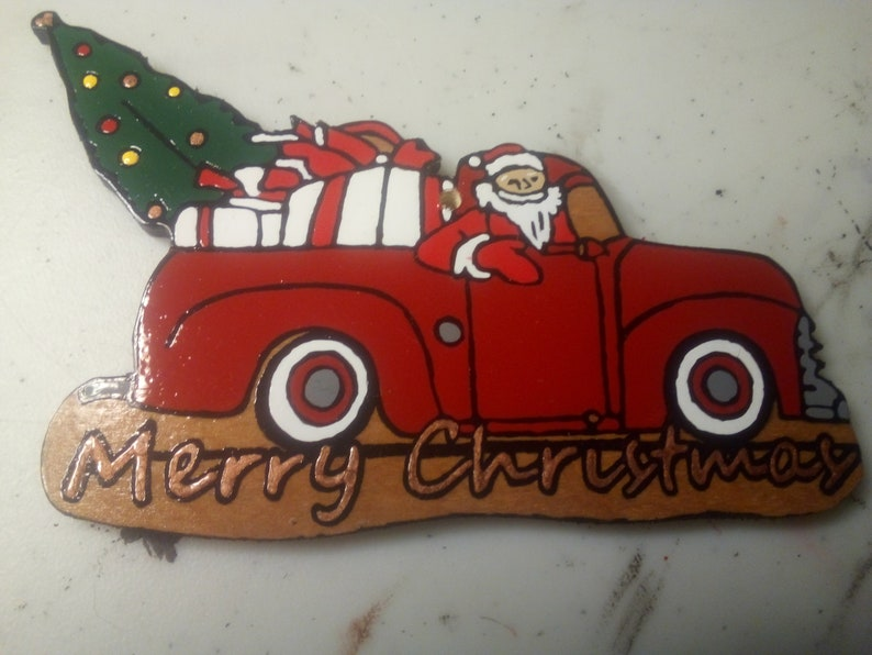 hand painted on 14 plywood with High Gloss Enamel paint. Santa in his Little Red Truck