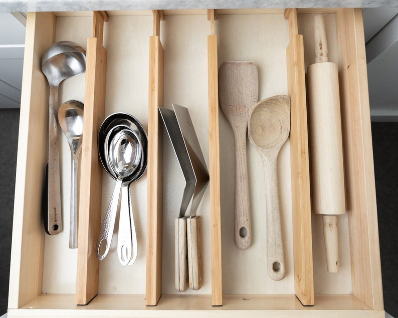 Kitchen organization products are what help make a kitchen more efficient. If you can't find what you need quickly, everything takes longer! Get a more efficient kitchen with these organization products you'll find on Etsy. These drawer dividers are a game changer!