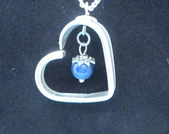 Silverware Jewelry FLOATING HEART PENDANT.One of a kind.Handmade.from a vintage silver spoon handle. This one has a blue stone dangle.