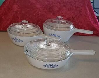 Vintage Corning Ware Blue Cornflower 3 handled Menu-ette casseroles.  Marked  P-81-B, P-82-B, and P-83-B. All with lids.