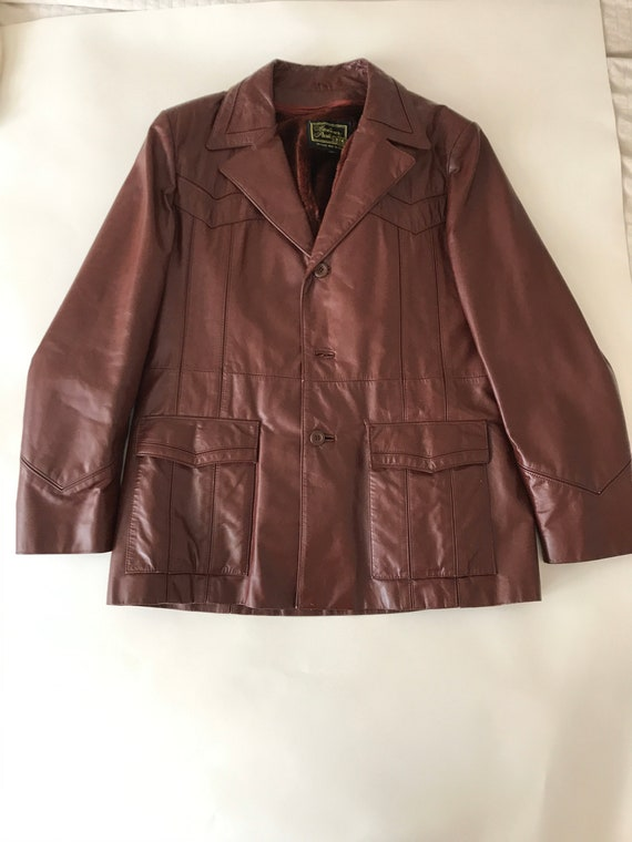 Coat: brown leather blazer, probably from the 70s;