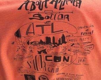 Peach Colored ATL Soccer Con Shirt