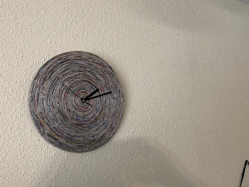 rolled newspaper. recycled Wall Clock; Upcycled