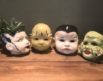 Monster doll heads  planters