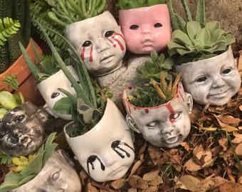 Creepy baby head succulents planter