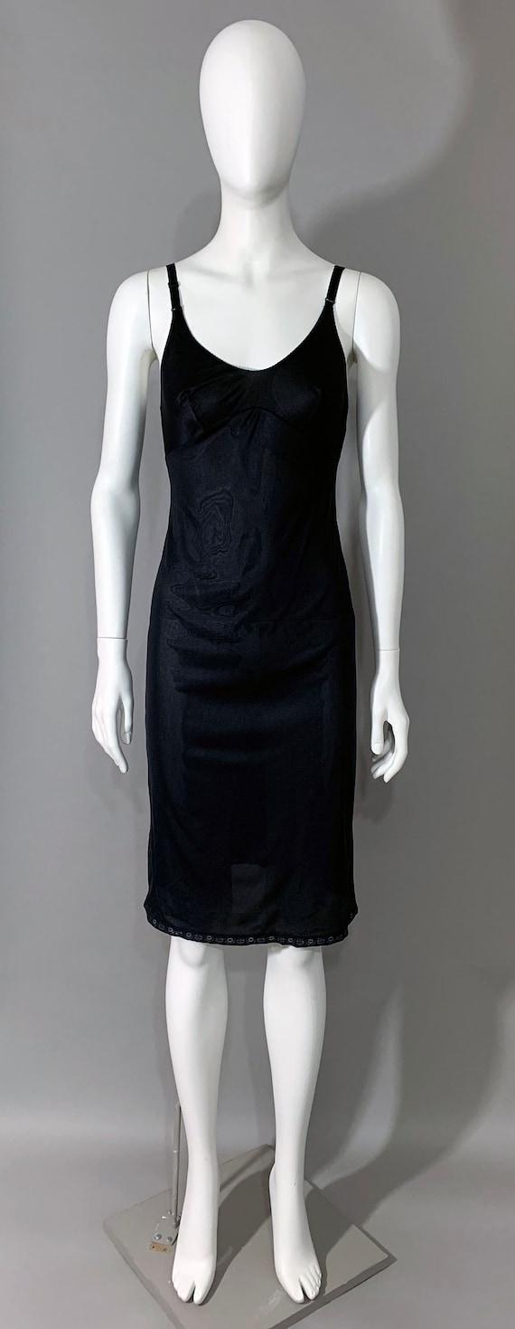 "1970s Women's ""Sears..The Doesn't Slip"" Black Mini"