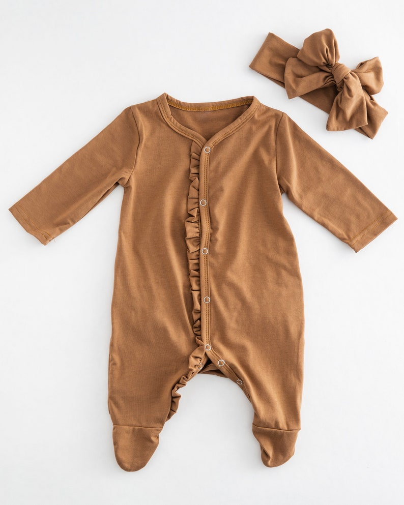 ruffle butterscotch color onesie and bow baby girl