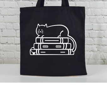 """Cat on Books 