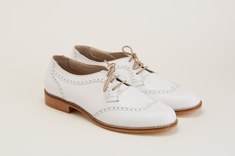 Men's 1920s Shoes History and Buying Guide Men Swing Dance Shoes Men's Oxfords white leather handmade by Harlem Shoes $202.69 AT vintagedancer.com