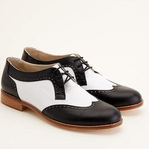 1970s Men's Clothes, Fashion, Outfits Men Swing Dance Shoes Men's Oxfords black & white leather handmade by Harlem Shoes $202.69 AT vintagedancer.com