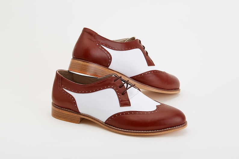 Men's 1920s Shoes History and Buying Guide Men Swing Dance Shoes Men's Oxfords brown & white leather handmade by Harlem Shoes $202.69 AT vintagedancer.com