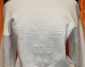 White on White Embossed Shield Cold Shoulder Top