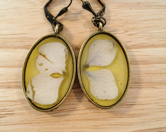 Nickel free antique bronze coloured dried flowers oval earrings