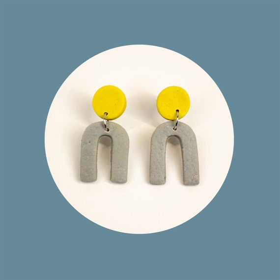 Small, polymer clay, arches, in grey and yellow, that are nickel-free   cool, colour block, arc earrings   mini u earrings