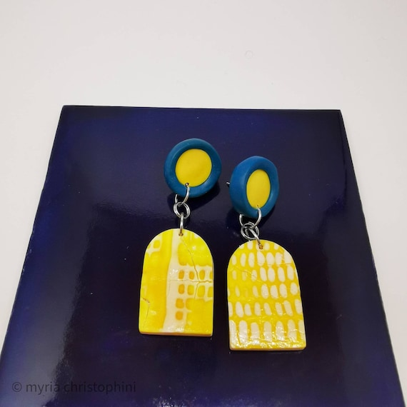 Yellow and blue arched earrings