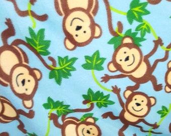 Monkey Around on Blue Fleece Fabric by the Yard