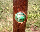 43 quot Twisted Sweet Gum Walkingstick with a inlay grip, paracord wrist strap, glossy bark upper portion a green elephant centeriece.