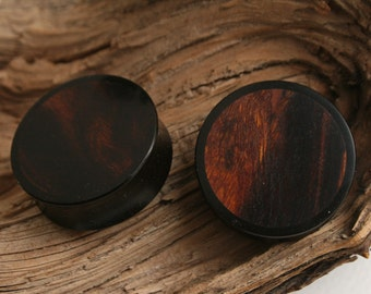25mm to 40mm Black Walnut and Resin custom cut plugs.