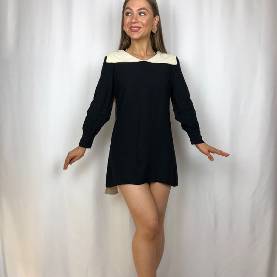 1960s black dress/top with white peter pan collar.