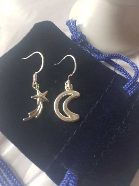 Pentagram and Birthstone Earrings and Pendant Set suspended on sterling silver earwires presented in a blue velvet pouch.