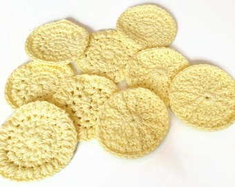 reusable, crocheted cosmetic pads in yellow