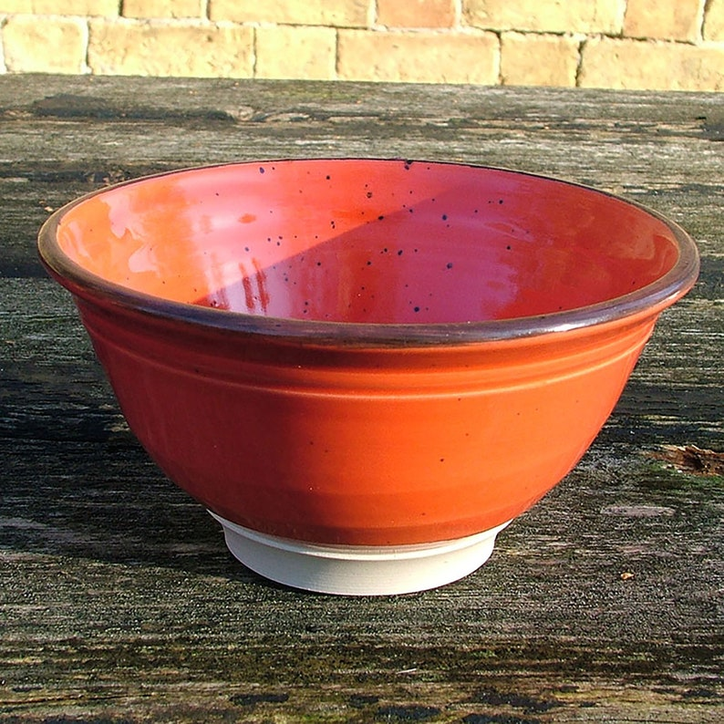 Thrown pottery red cereal bowl image 0