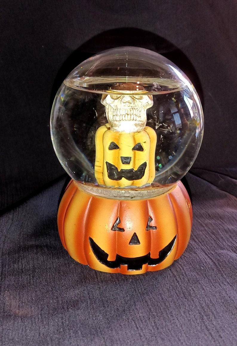 5 Halloween Snow Globe used