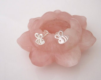 A pair of small BEE cutout sterling silver stud earrings