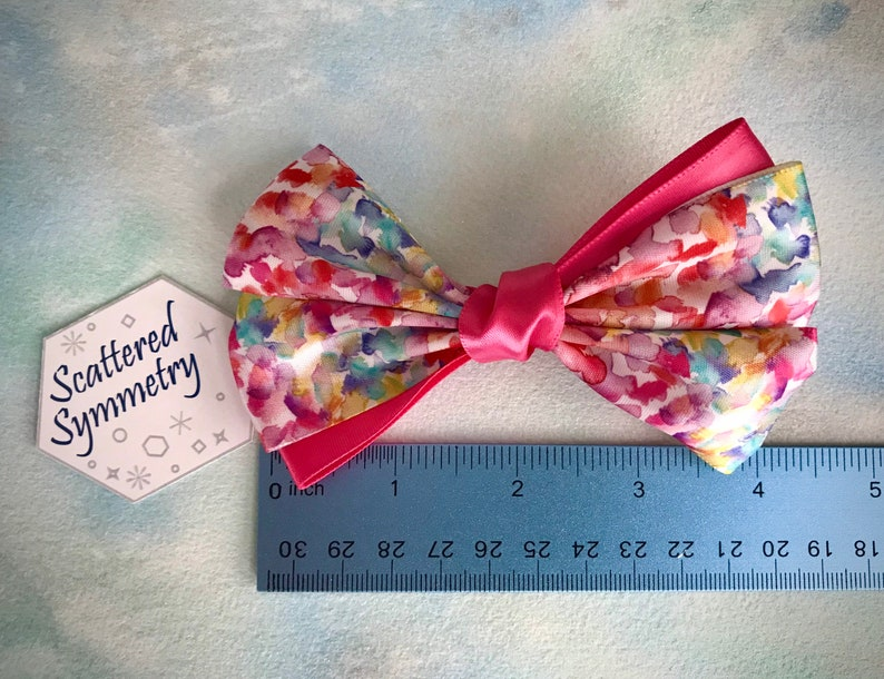 toddler bow set on an alligator clip with teeth girls bow Watercolor hair bow with bright hot pink accents multi-color bow
