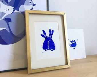 Linogravure rabbit cuddle
