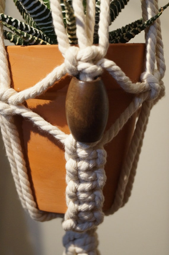 All Seeing Eye - Macrame Plant Hanger / Wall Hanging with Big Wooden Beads and a Beachwood Rod for Hanging.
