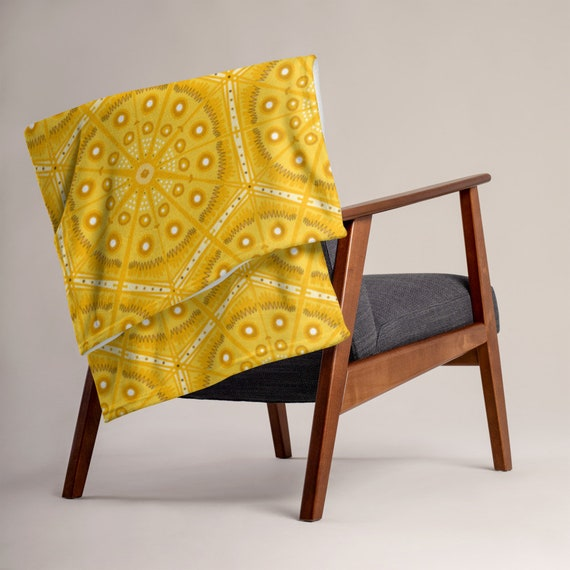 Soft as Silk Throw Blanket with Amber Coloured Batik Style Pattern.