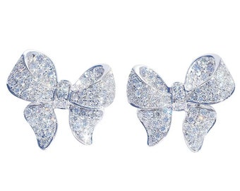 Women's stud earrings with a cute bow made of 925 sterling silver with a cubic Zirconia stone. Trendy and very cool.