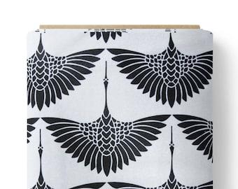 Supersoft fleece fabric with black geometric cranes