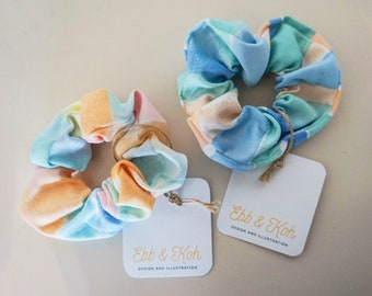 Hair scrunchie - hand painted fabric & hand sewn, each one unique. Ocean inspired colour palette- blues, greens, pinks, oranges.