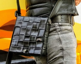 recycled & retyred shoulder bag from reused bicycle rubber tubes. tyres ecological recycling dutch design sustainable cycling accessory hip