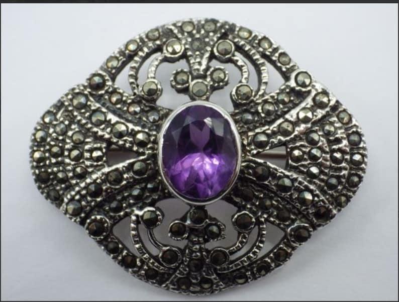 Vintage sterling and amethyst brooch