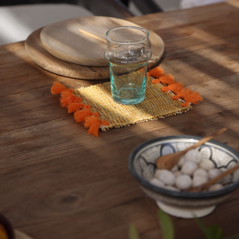 Moroccan glass bottoms with pom-poms and wicker for cooking and table decoration